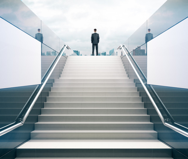 Businessman on white stairs
